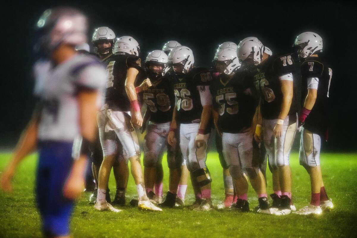 Bullock Creek players huddle up during a game against Nouvel Catholic Central Friday, Oct. 11, 2019 at Bullock Creek High School. (Katy Kildee/kkildee@mdn.net)