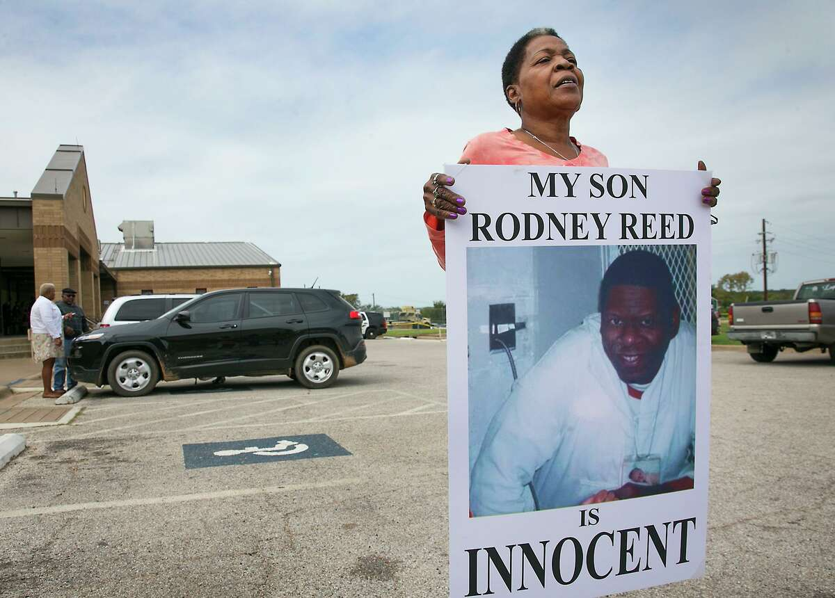 Sandra Reed, the mother of death row inmate Rodney Reed, shows her continued support of her son by carrying this placard around the parking lot during a break in a hearing in Bastrop County District Court on Tuesday, October 10. 2017. Reed was asking Judge Doug Shaver to reconsider testimony from his murder trial in the slaying of Stacey Stites.