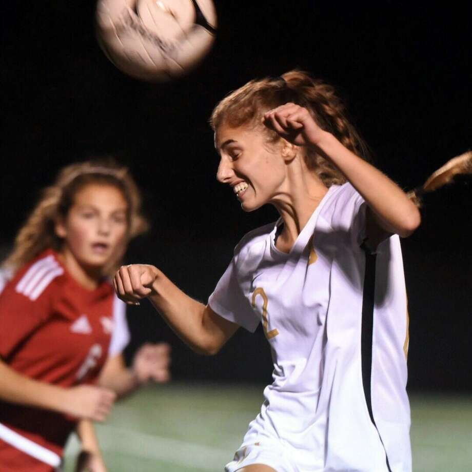 St. Joseph's Ashley Collins (12) goes up for a header during a girls soccer game between St. Joseph and New Canaan at Dunning Field on Friday, Oct. 11, 2019. Photo: David Stewart / Hearst Connecticut Media / Connecticut Post