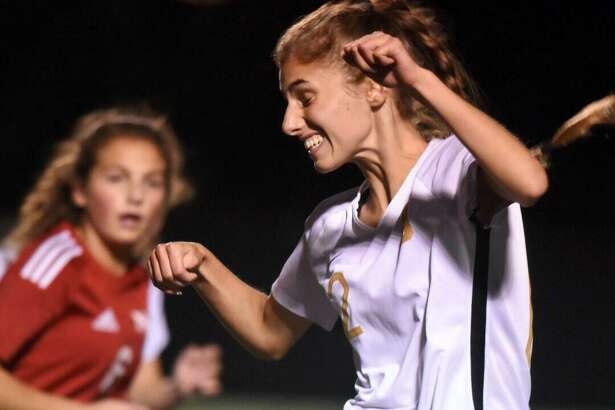 St. Joseph's Ashley Collins (12) goes up for a header during a girls soccer game between St. Joseph and New Canaan at Dunning Field on Friday, Oct. 11, 2019.