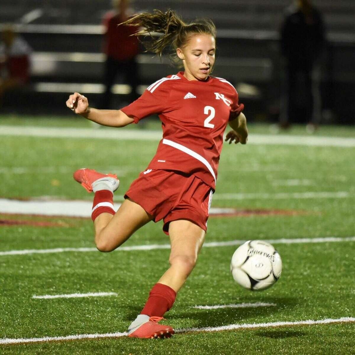 New Canaan's Sophie Potter (2) lines up a kick during Friday's game against St. Joseph at Dunning Field on Friday.