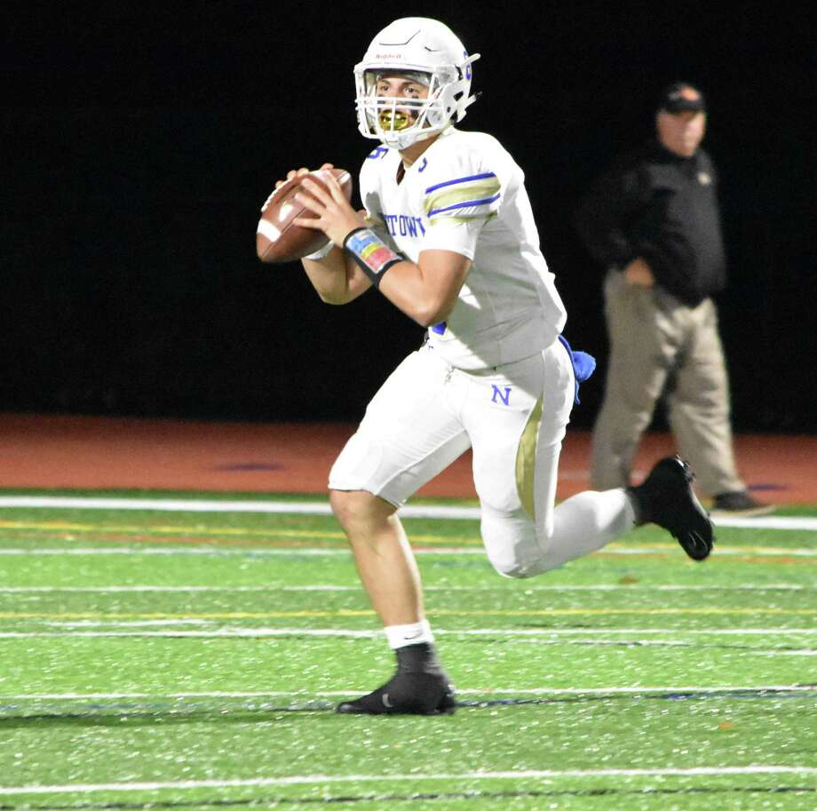 Newtown's Brandon Lomabrdo throws a pass against Shelton at Finn Stadium, Shelton on Friday, Oct. 11, 2019. (Pete Paguaga, Hearst Connecticut Media) Photo: Pete Paguaga / Hearst Connecticut Media / Connecticut Post