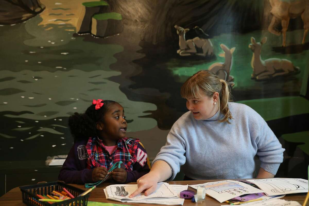 Volunteer tutor Natalie Skinner (right) works with Jaylene (left), 8, during after school tutoring at 826 Valencia Mission Bay on Tuesday, February 26, 2019 in San Francisco, Calif.