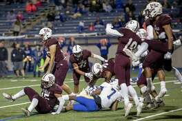 Lee players celebrate after sacking Frenship's quarterback Donovan Smith on a fourth down Friday, Oct. 11, 2019 at Grande Communications Stadium. Jacy Lewis/Reporter-Telegram