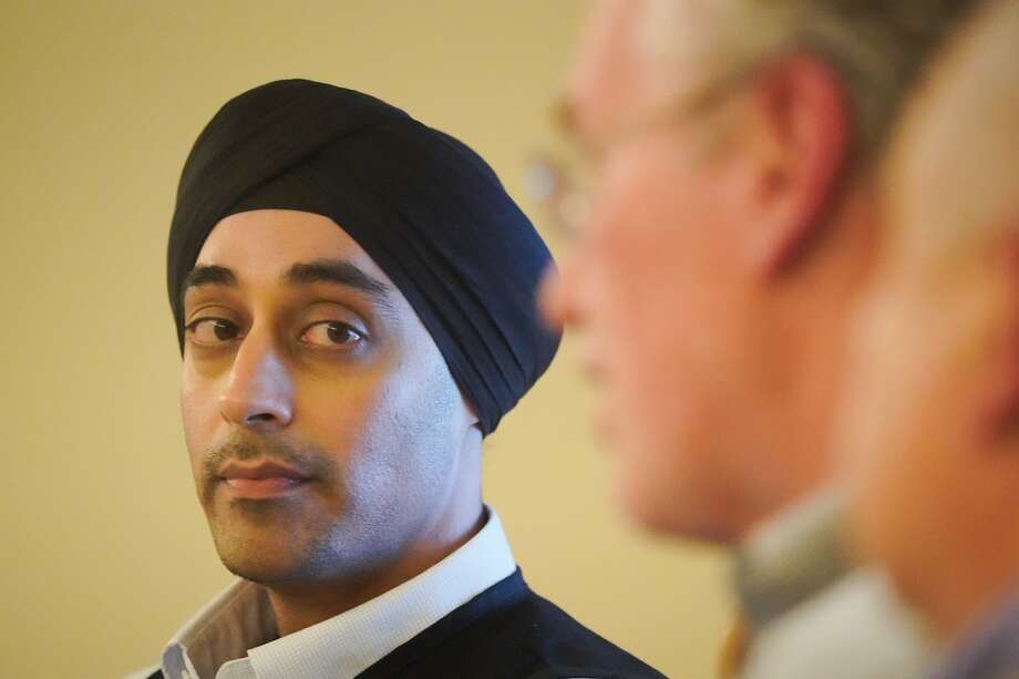 Sumeet Singh, Vice President, Asset and Risk Management and Community Wildfire Safety Program, listens to Bill Johnson, PG&E Corp. CEO and President at a news conference on Friday, Oct. 11, 2019 in San Francisco, Calif. Photo: Paul Kuroda / Special To The Chronicle