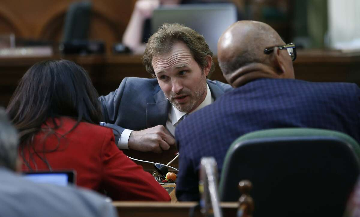 Assemblyman James Gallagher, R-Yuba City, center, talks with Assemblywoman Blanca Rubio, D-Baldwin Park, left, during the Assembly session at the Capitol in Sacramento, Calif., Friday, Sept. 13, 2019. Lawmakers have until midnight Friday, to pass bills before before they adjourn this year's legislative session. (AP Photo/Rich Pedroncelli)