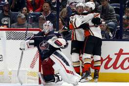 Anaheim Ducks forward Jakob Silfverberg, left, of Sweden, celebrates his goal with forward Rickard Rakell, of Sweden, behind Columbus Blue Jackets goalie Joonas Korpisalo, of Finland, during the second period of an NHL hockey game in Columbus, Ohio, Friday, Oct. 11, 2019. The Ducks won 2-1. (AP Photo/Paul Vernon)