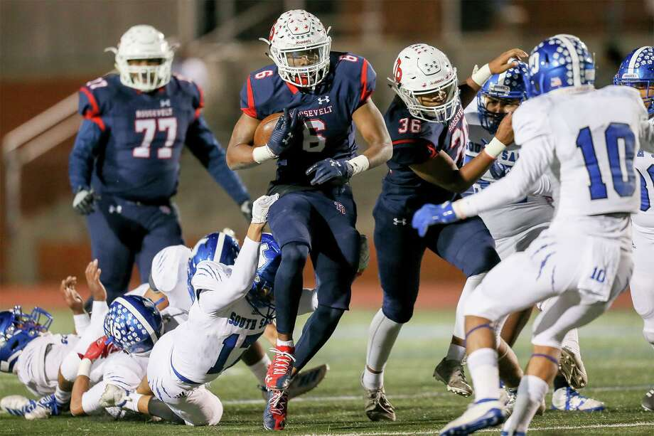 iRoosevelt running back Rashod Owens, center, breaks through the South San defense in the first half in their District 27-6A high school football game at Heroes Stadium on Friday, Oct. 11, 2019. Photo: Marvin Pfeiffer, Staff Photographer / Express-News 2019