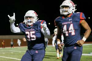 Roosevelt's Jorge Butron, left, celebrates his second half fumble recovery as he leaves the field with Jabri Wilson in their District 27-6A high school football game with South San Roosevelt at Heroes Stadium on Friday, Oct. 11, 2019. Roosevelt beat South San 46-0.