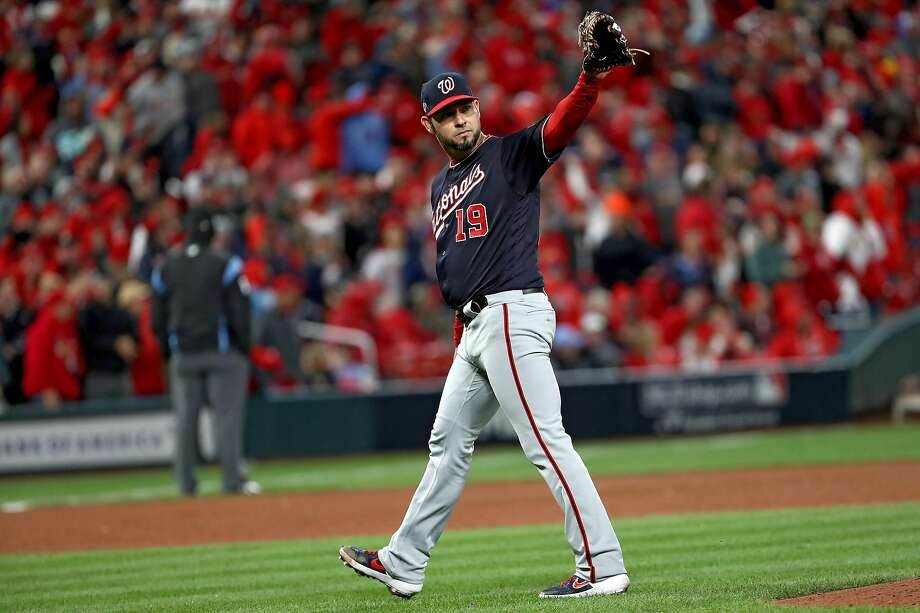 The Nationals' Anibal Sanchez departs while acknowledging Ryan Zimmerman, who saved his no-hit bid earlier in the eighth. Photo: Jamie Squire / Getty Images