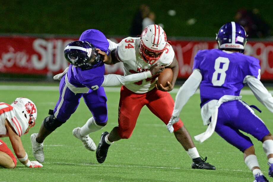 Ron Hoff (34) of Katy carries the ball during the third quarter of a 6A Region III District 19 football game between the Katy Tigers and the Morton Ranch Mavericks on Friday, October 11, 2019 at Rhodes Stadium, Katy, TX. Photo: Craig Moseley/Staff Photographer