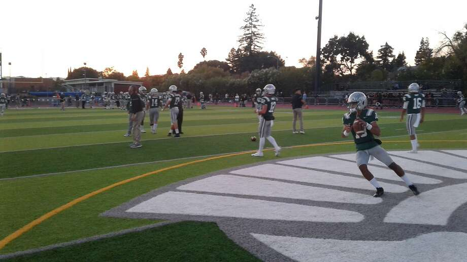 De La Salle's football team warms up before Friday night's game against California in Concord. Photo: Courtesy Damin Esper