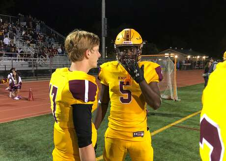 Isaiah Newell, right, enjoys some sideline chatter with Las Lomas quarterback Everett Johnson during the second half of the Knights 42-21 win over Acalanes on Friday.