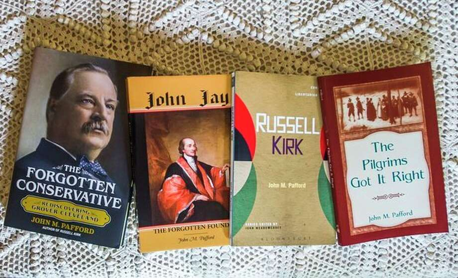 Previous books, above, by John M. Pafford of Midland. (Katy Kildee/kkildee@mdn.net)