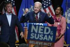 Former Vice President Joe Biden speaks at a rally supporting Democrats as Ned Lamont for candidate for Governor, left, and Jahana Hayes, candidate for Congress, right, look on in Hartford, Conn., Friday, Oct. 26, 2018.