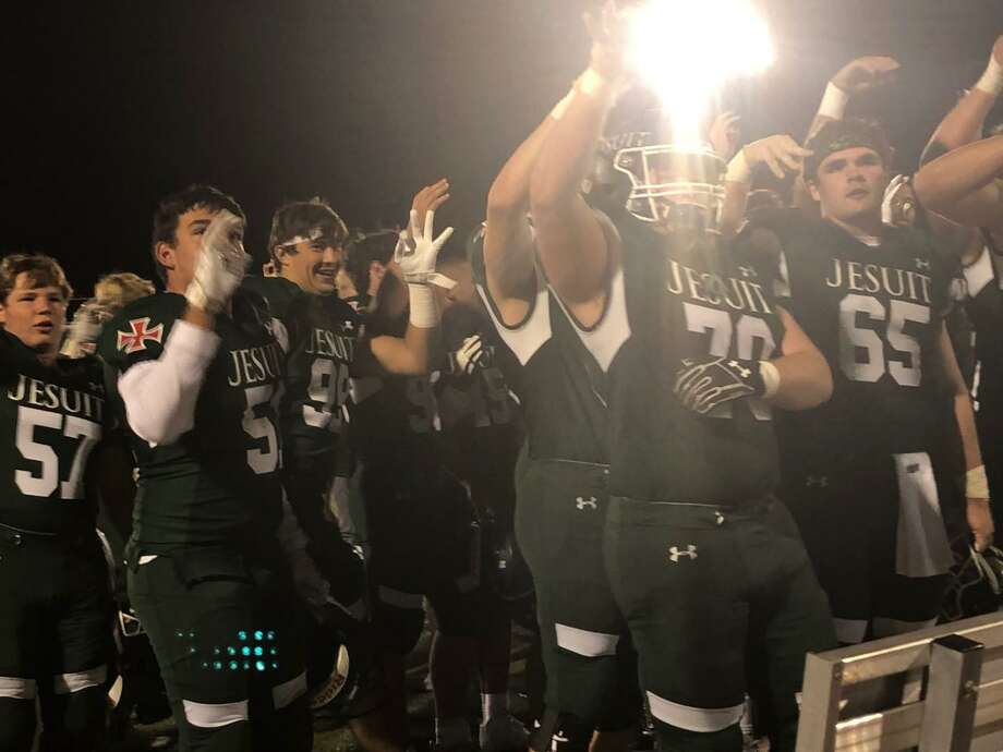 The Strake Jesuit football team celebrates its 24-7 victory against Hastings, Oct. 11 at Clay Stadium. The Crusaders improved to 4-2 overall, 2-1 in District 23-6A. Photo: Elliott Lapin / Houston Chronicle
