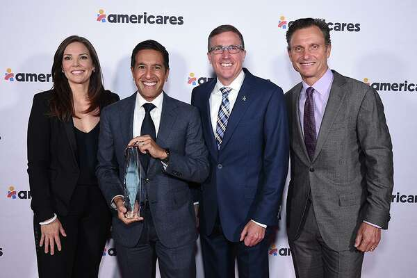 CNN anchor Erica Hill, CNN Chief Medical Correspondent and honoree Dr. Sanjay Gupta, Americares President and CEO Michael J. Nyenhuis and actor and Americares board member Tony Goldwyn at the Americares Airlift Benefit at Westchester County Airport on Oct. 5.