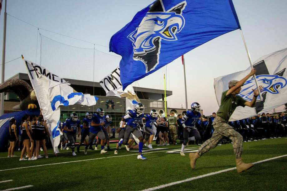 The New Caney Eagles take the field before a District 9-5A (Div. I) footbal game Friday, October 4, 2019 at Randall Reed Stadium in New Caney. Photo: Cody Bahn, Houston Chronicle / Staff Photographer / © 2019 Houston Chronicle