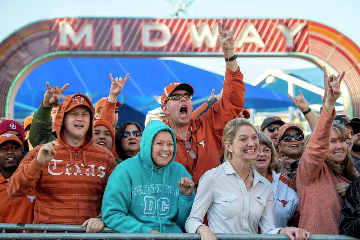 Texas fans cheer before an NCAA college football game between against Oklahoma at the Cotton Bowl, Saturday, Oct. 12, 2019, in Dallas.