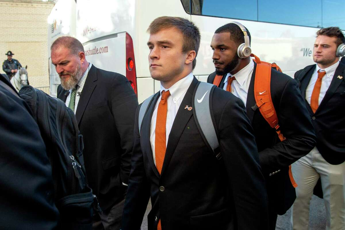 Texas quarterback Sam Ehlinger gets off the bus before an NCAA college football game against Oklahoma at the Cotton Bowl, Saturday, Oct. 12, 2019, in Dallas.