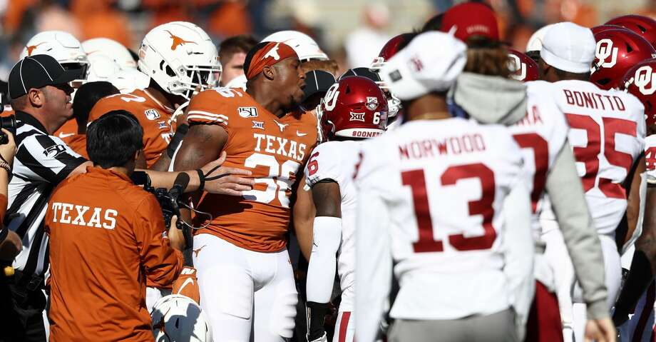 DALLAS, TEXAS - OCTOBER 12:  Jacoby Jones #36 of the Texas Longhorns yells during a scuffle against the Oklahoma Sooners before the 2019 AT&T Red River Showdown at Cotton Bowl on October 12, 2019 in Dallas, Texas. (Photo by Ronald Martinez/Getty Images) Photo: Ronald Martinez/Getty Images