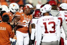 DALLAS, TEXAS - OCTOBER 12: Jacoby Jones #36 of the Texas Longhorns yells during a scuffle against the Oklahoma Sooners before the 2019 AT&T Red River Showdown at Cotton Bowl on October 12, 2019 in Dallas, Texas. (Photo by Ronald Martinez/Getty Images)