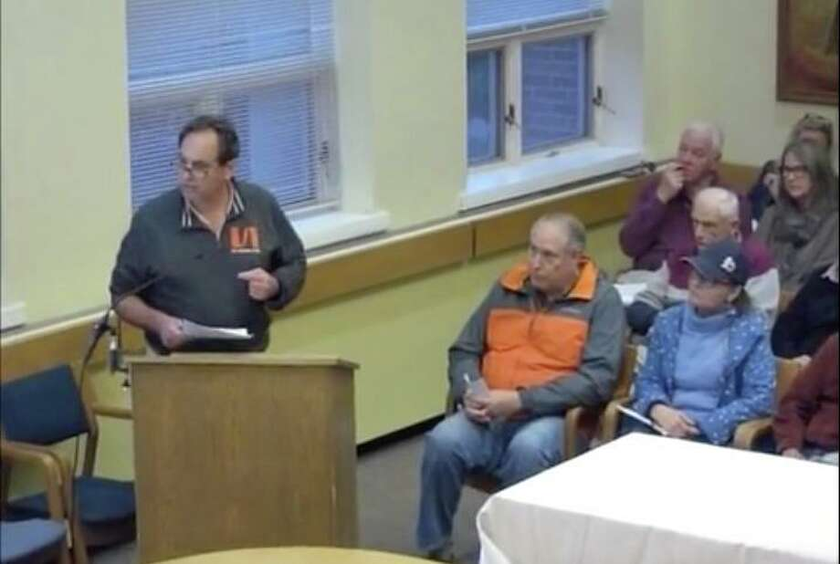 Darien resident Perry Boyle spoke out against the proposed renovations to Pear Tree Point Beach at a recent meeting. Photo: Darien TV79 / / Connecticut Post