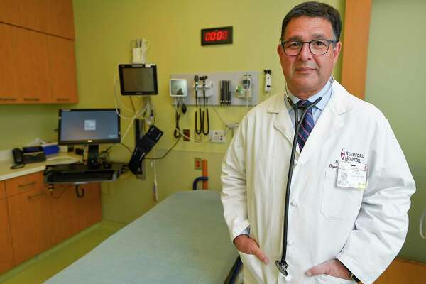 Dr. Rod Acosta, President and CEO of the Stamford Health Medical Group, is photograph on Oct. 10, 2019 in a clinical room at Stamford Hospital. Acosta explained that there are other healthcare alternatives such as walk-in clinics and urgent care centers in the city for residents who don't have health insurance or don't suffer from immediately clear emergency room situations.