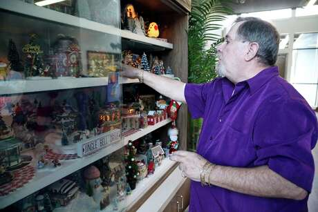 Glenn Dresh sets up the Christmas display at a Ronald McDonald House near the Medical Center. For the past 15 years, Dresh has used his own time and money to keep the spirit of Christmas alive for sick children at all four local Ronald McDonald Houses by maintaining yuletide displays all year long.