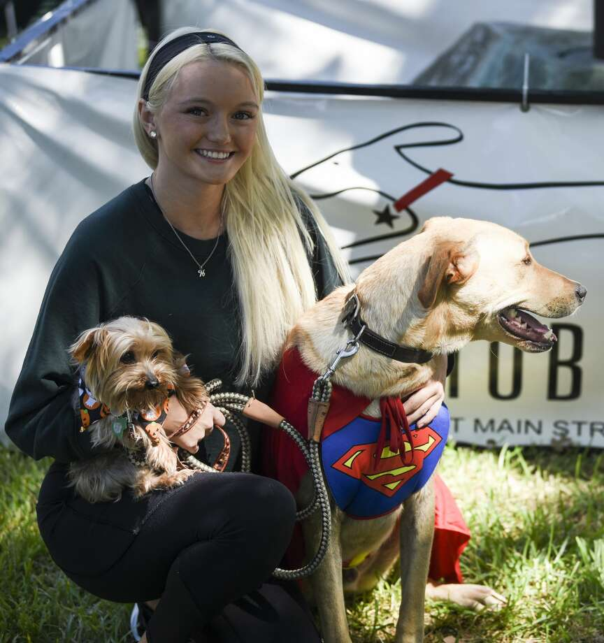 Haleigh Stark with Gunner and Presley at Beaumont's Dogtober Fest near the downtown library Saturday afternoon. Photo taken on Saturday, 10/12/19. Ryan Welch/The Enterprise Photo: Ryan Welch/The Enterprise