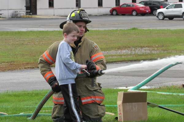 Families visit Midland Fire Department on Saturday, Oct. 12 for the department's annual open house.