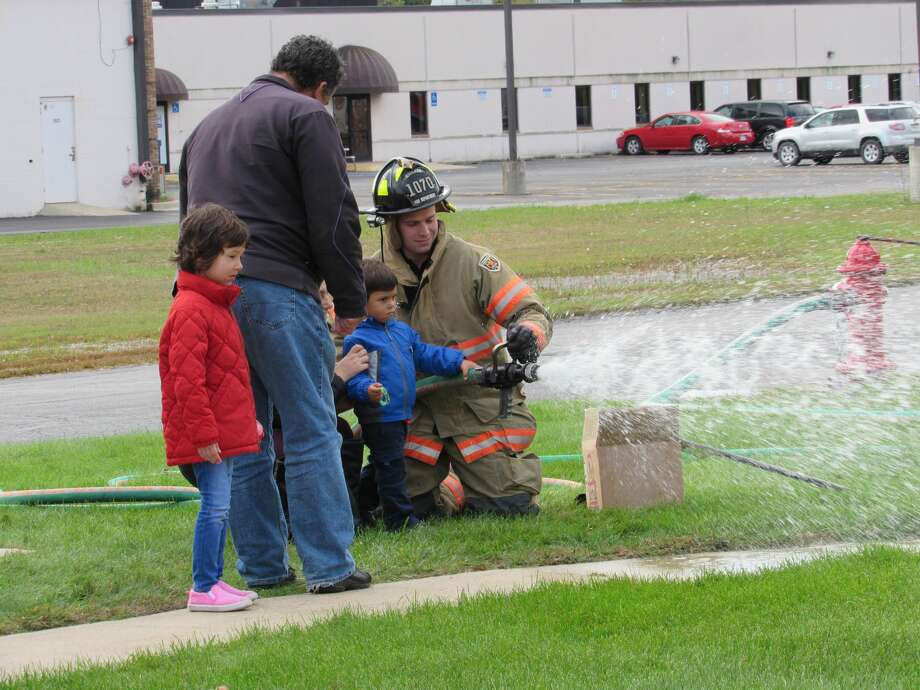 Families visit Midland Fire Department on Saturday, Oct. 12 for the department's annual open house. Photo: (Victoria Ritter/vritter)