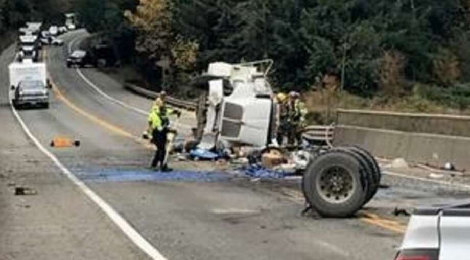 All lanes blocked after tanker truck rolls over on SR 18 Photo: Washington State Patrol