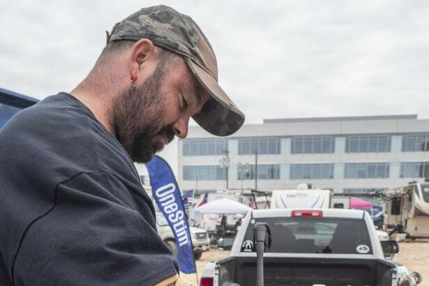 Levi Priddy with team Black Sheep, seasons his butter glaze 10/12/19 as he and other teams cook brisket, chicken, chilli and other smoked treats outside the American Legion Post off Veterans Park Lane during the annual Patsy's Cook-off Breast Cancer Awareness competition. Tim Fischer/Reporter-Telegram