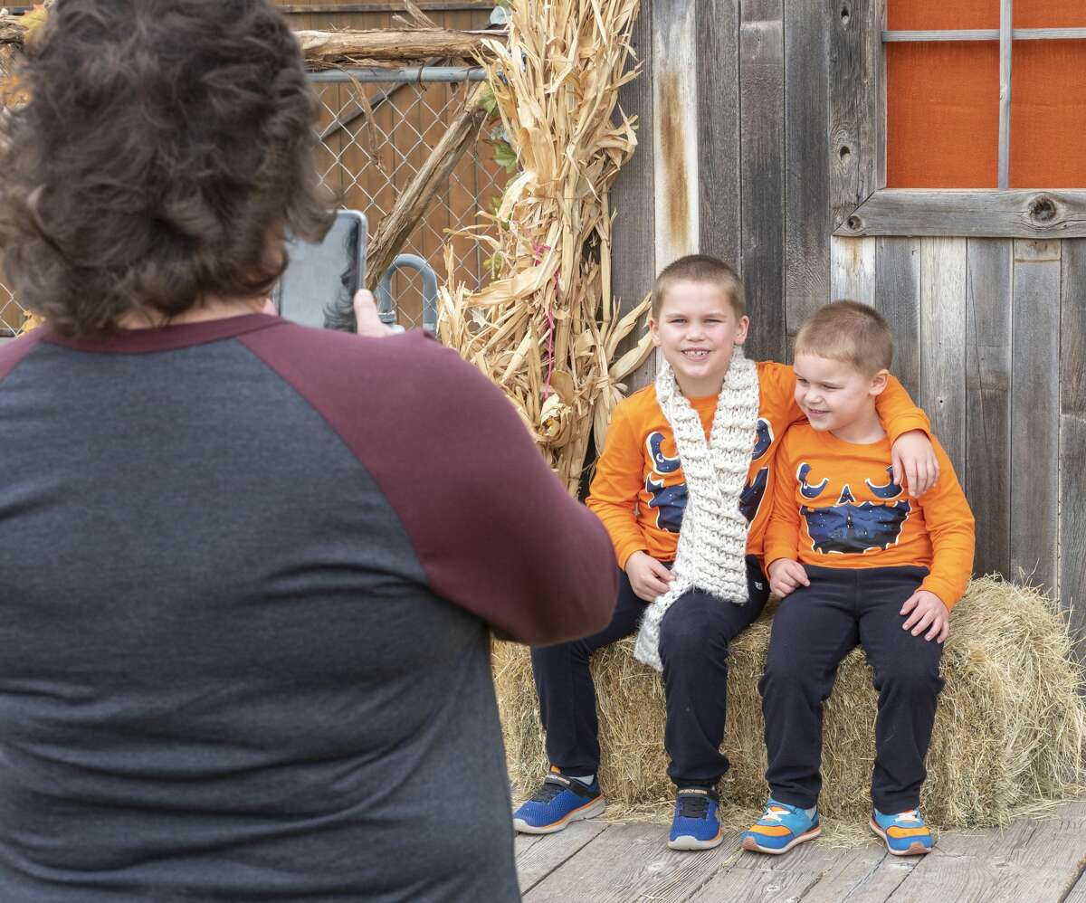 Kara Pavelock takes pictures of her grandsons, Noah and Jacob Pavelock 10/12/19 at the St. Luke's United Methodist Pumpkin Patch. Tim Fischer/Reporter-Telegram