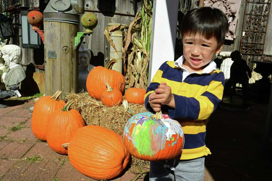 Three-year-old Aiden Chee shows off his pumpkin as United House Wrecking hosts a pumpkin painting event for kids Saturday October 12, 2019 in Stamford, Conn. United House Wrecking supplies paints, pumpkins, and brushes Saturdays and Sundays from noon to 3pm through October. Photo: Erik Trautmann / Hearst Connecticut Media / Norwalk Hour