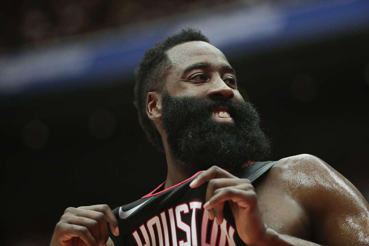 Houston Rockets' James Harden smiles during the first half of an NBA preseason basketball game against the Toronto Raptors Thursday, Oct. 10, 2019, in Saitama, near Tokyo. (AP Photo/Jae C. Hong)
