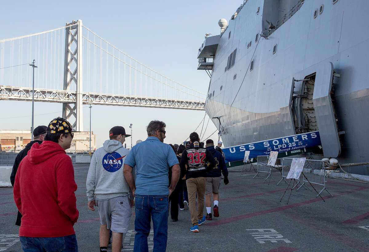 Crowds walk to enter the ship during a tour aboard the USS Somerset naval warship during Fleet Week festivities in San Francisco, Calif. Saturday, Oct. 12, 2019.