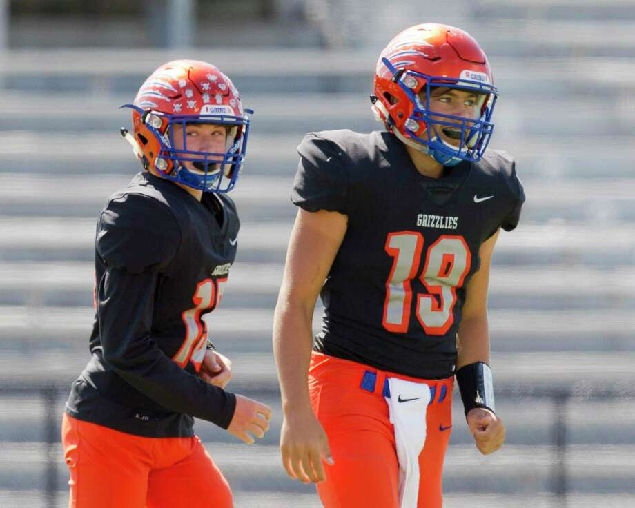 Grand Oaks quarterback Hudson Hamilton (19) is seen after throwing a 3-yard touchdown pass to wide receiver Brett Wilson (15) is seen after catching a 3-yard touchdown during the first quarter of a non-district high school football game at Buddy Moorhead Stadium, Saturday, Oct. 12, 2019, in Conroe. Photo: Jason Fochtman, Houston Chronicle / Staff Photographer / Houston Chronicle