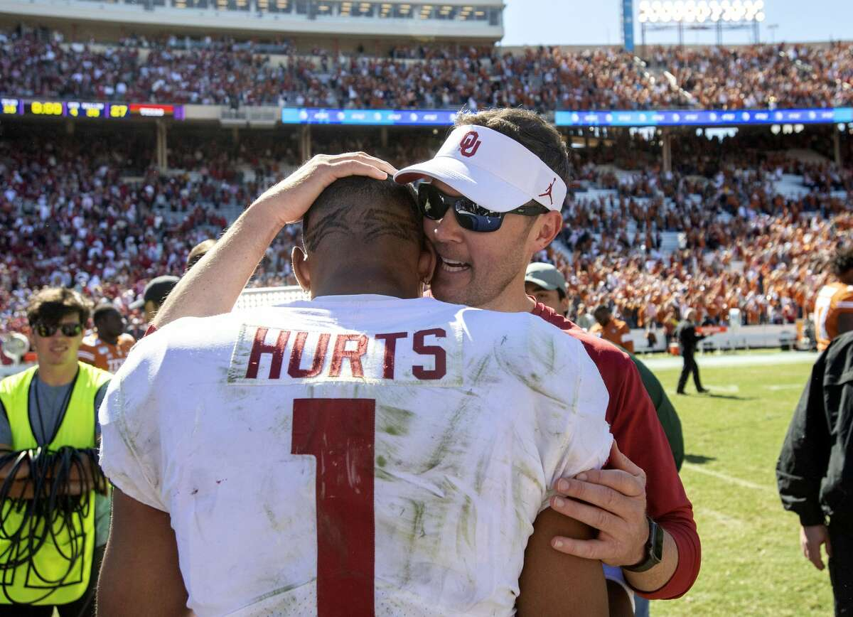 Oklahoma head coach Lincoln Riley congratulates quarterback Jalen Hurts (1) after beating Texas 34-27 in an NCAA college football game at the Cotton Bowl, Saturday, Oct. 12, 2019, in Dallas.