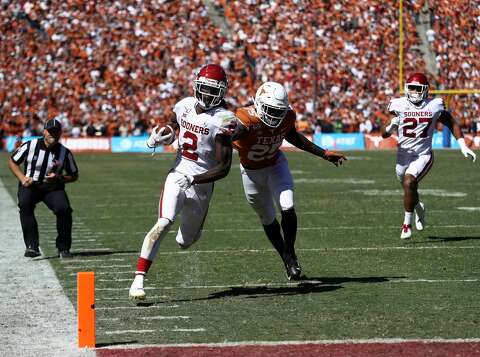 Image result for CeeDee lamb Photos Against Texas