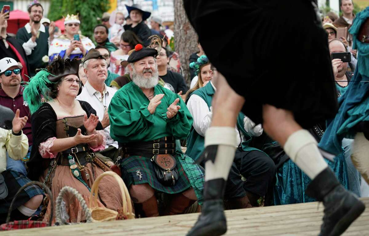 People listen to Tartanic, a pipe and drum band, perform during the Texas Renaissance Festival Saturday, Oct. 12, 2019, in Todd Mission.