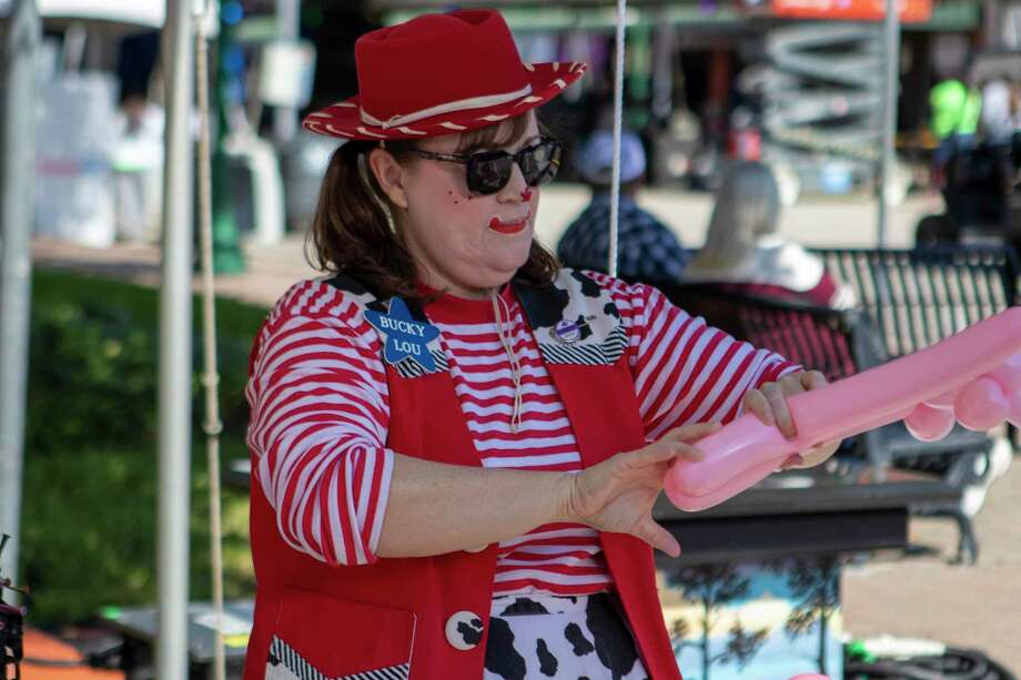 Performer Bucky Lou makes a balloon dog during the 30th annual Conroe Cajun Catfish Festival on Saturday, October 12, 2019 in Conroe. Photo: Cody Bahn, Houston Chronicle / Staff Photographer / © 2019 Houston Chronicle