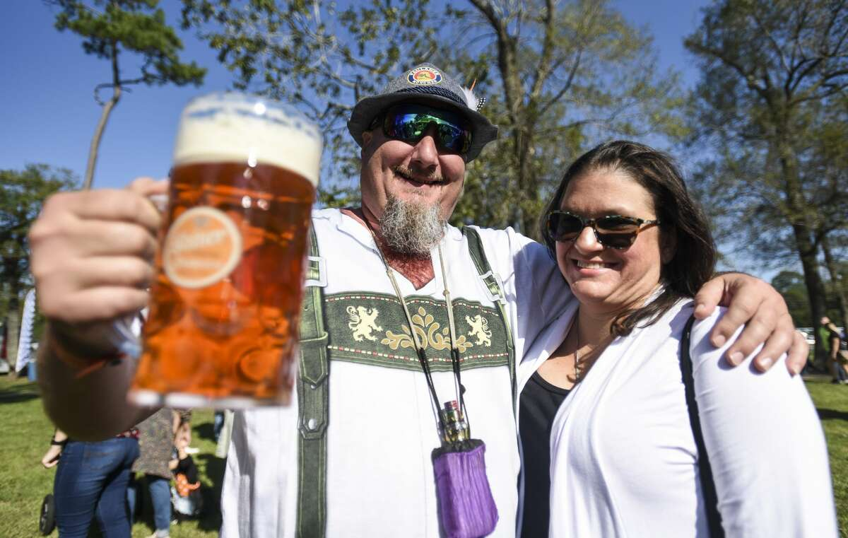 Shawn and Kimberly Hashop enjoy beer, food and live music at Beaumont's Oktoberfest Saturday afternoon. Photo taken on Saturday, 10/12/19. Ryan Welch/The Enterprise