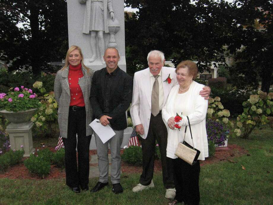 Albert Persechino, Torrington's Italian Mayor of the Day, third from left, stands in front of the Christopher Columbus monument off East Main Street in Torrington on Saturday, during the city's Columbus Day celebration. He is joined by his wife, Connie, state Rep. Michelle Cook, left, and Torrington UNICO president Brian Mattiello. Photo: John Torsiello / Hearst Connecticut Media /