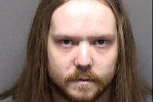 Adam Thomas Converse, 25, was charged with threatening Mayor Ron Nirenberg and resisting arrest.