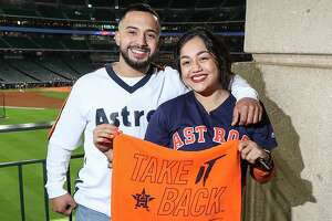 Fans pose for a photo before Game 1 of the American League Championship Series at Minute Maid Park on Saturday, Oct. 12, 2019, in Houston.