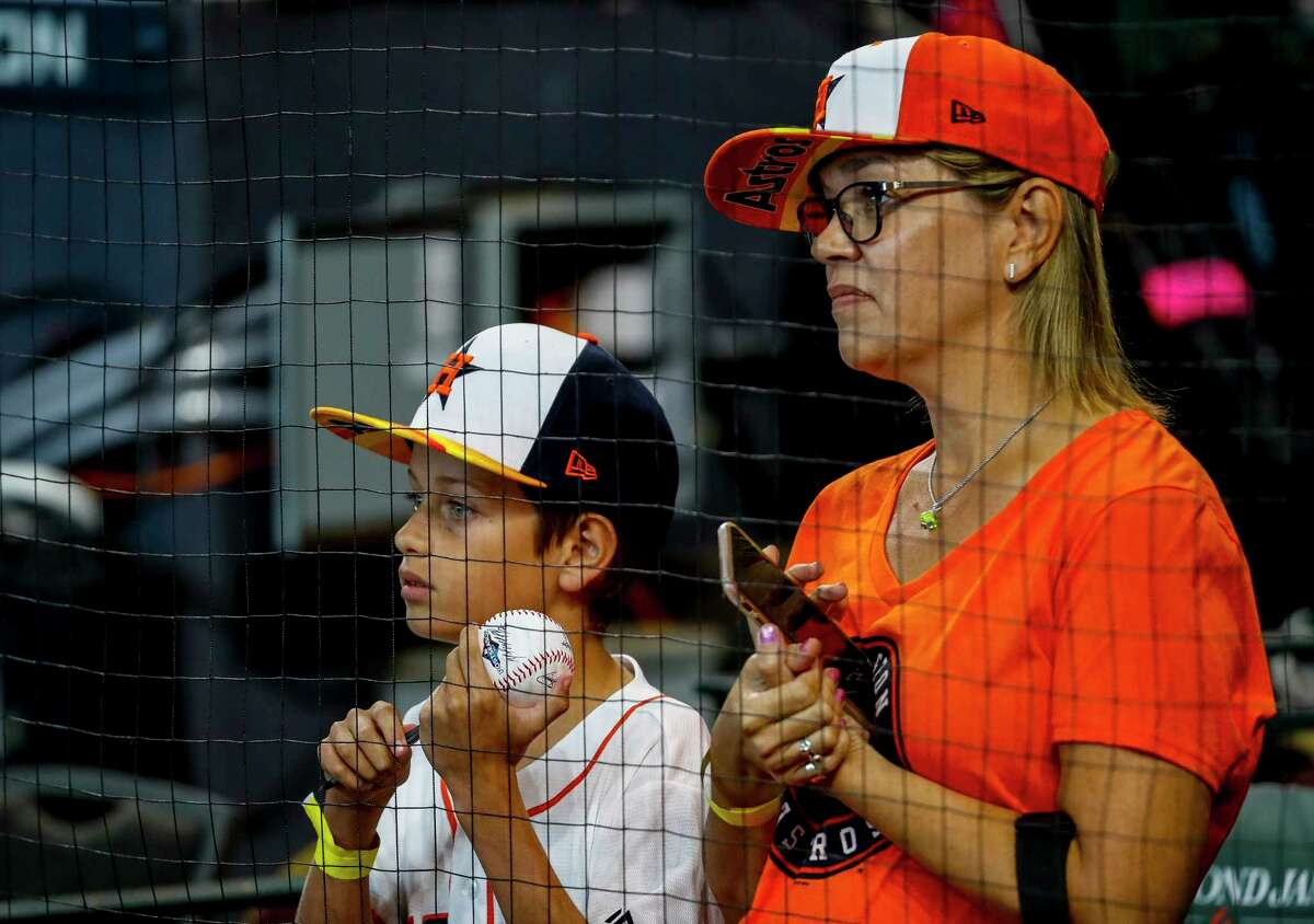 Astros fans watch batting practice before Game 1 of the American League Championship Series at Minute Maid Park on Saturday, Oct. 12, 2019, in Houston.