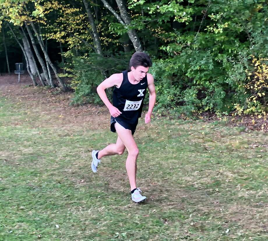 Xavier's Robbie Cozean won the Wickham Park Invite Saturday. Photo: Ryan Lacey / Hearst Connecticut Media