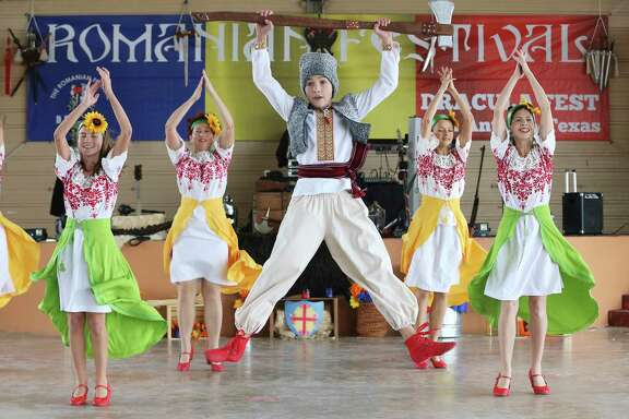 Victoria Schwem, 13, leaps into the air in a traditional Ukrainian dance called Marichka, in which a bachelor implores bachelorettes at a party to be more energetic in their dancing in hopes of courting a husband. It was performed at the San Antonio Romanian community's third annual Dracula Festival at Rosedale Park on Saturday.. (Kin Man Hui/San Antonio Express-News)